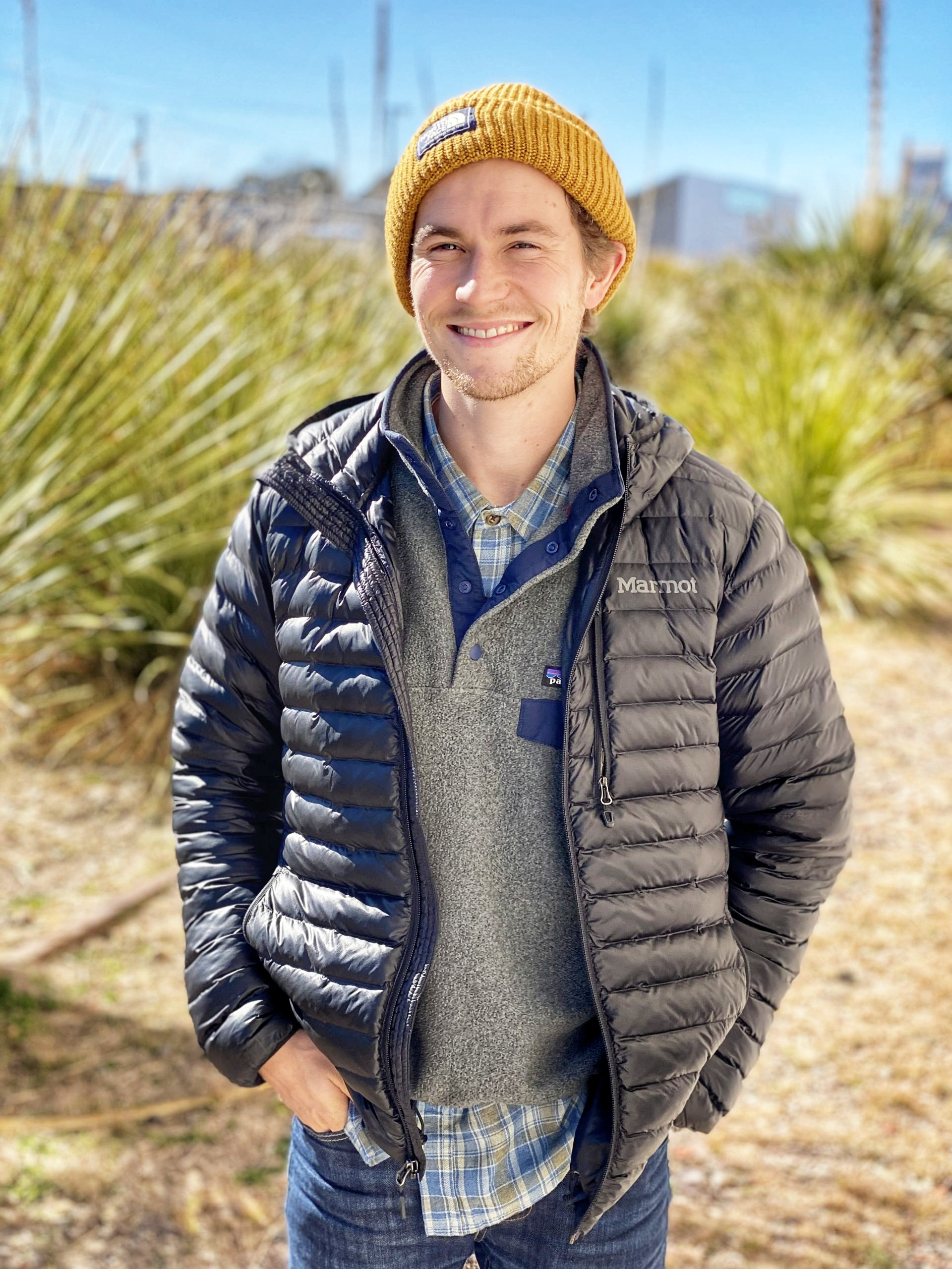 Cory Ames CEO of Grow Ensemble wearing yellow beanie and jacket